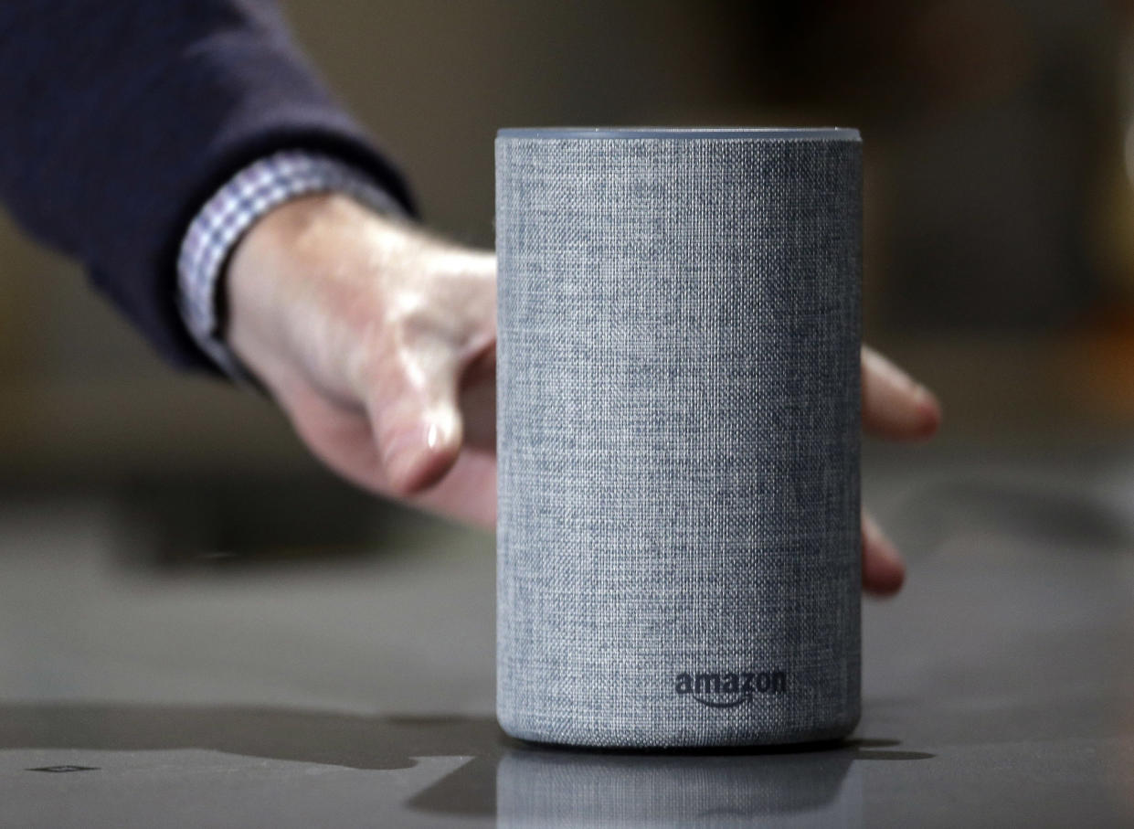 An Amazon Echo is displayed during a program announcing several new Amazon products by the company, in Seattle. (AP Photo/Elaine Thompson, File)