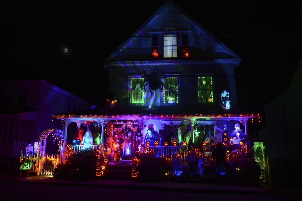 A house along Park Avenue in the Schoentown section of Port Carbon, Pa., is covered in Halloween decorations on Wednesday, Oct. 28, 2020. The backyard is also decorated. (Lindsey Shuey/The Republican-Herald via AP)