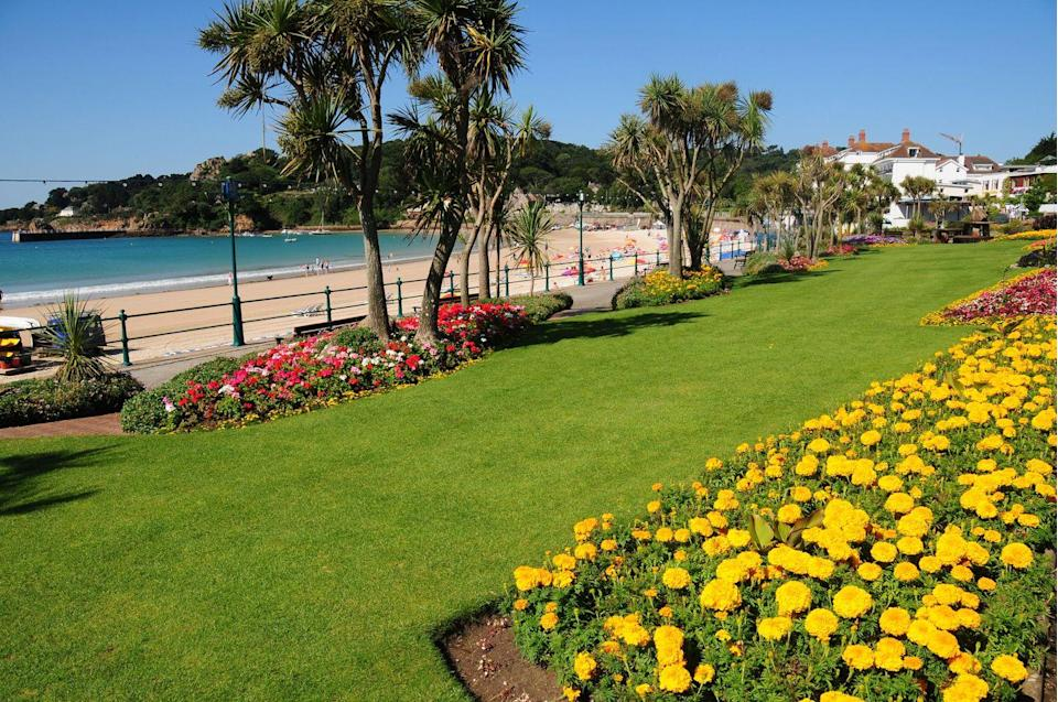 "<p>St Brelade's Bay Beach on the island of Jersey is renowned for its elegant green-railinged boardwalk and famous restaurant, Oyster Box.</p><p><a class=""link rapid-noclick-resp"" href=""https://go.redirectingat.com?id=127X1599956&url=https%3A%2F%2Fwww.booking.com%2F&sref=https%3A%2F%2Fwww.cosmopolitan.com%2Fuk%2Fentertainment%2Ftravel%2Fg4958%2Fbest-beaches-in-uk%2F"" rel=""nofollow noopener"" target=""_blank"" data-ylk=""slk:FIND ACCOMMODATION"">FIND ACCOMMODATION </a></p>"