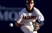 Arizona shortstop Nik McClaughry tracks down a roller up the middle by Mississippi's Hayden Dunhurst for the out during the second inning in an NCAA college baseball tournament super regional game Friday, June 11, 2021, in Tucson, Ariz. (Kelly Presnell/Arizona Daily Star via AP)