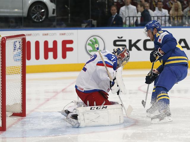 Sweden forward Oscar Moller shoots past Russia goaltender Sergei Bobrovski to score the opening goal during a semifinal match between Russia and Sweden at the Ice Hockey World Championship in Minsk, Belarus, Saturday, May 24, 2014. (AP Photo/Darko Bandic)
