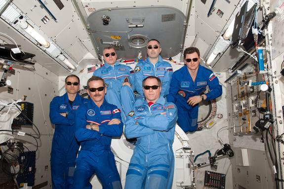 The International Space Station's Expedition 34 crew pose for a team portrait with sunglasses. Pictured on the front row are NASA astronaut Kevin Ford (right), commander; and Canadian Space Agency astronaut Chris Hadfield, flight engineer. Pict