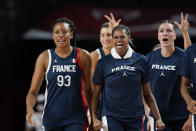 France's Diandra Tchatchouang (93) celebrates with teammates on the bench during a women's basketball quarterfinal round game against Spain at the 2020 Summer Olympics, Wednesday, Aug. 4, 2021, in Saitama, Japan. (AP Photo/Eric Gay)