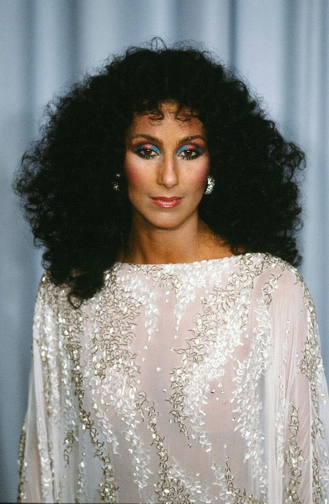 <p>Today's rainbow-lash trend's got nothing on the 1983 striped lids sported by Cher, who also opted for a poof of curls over usually straight locks. <i>(Photo: Getty Images)</i></p>