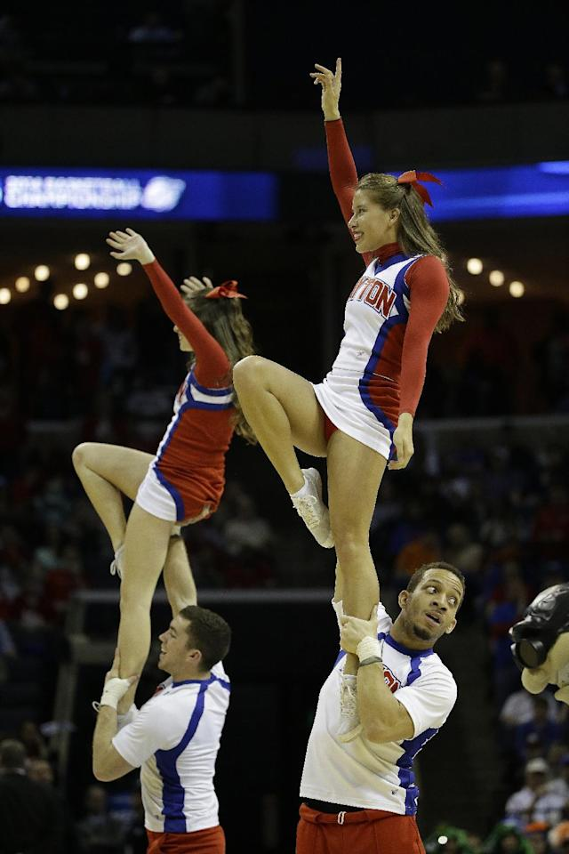 Dayton cheerleaders perform against Florida during the first half in a regional final game at the NCAA college basketball tournament, Saturday, March 29, 2014, in Memphis, Tenn. (AP Photo/Mark Humphrey)