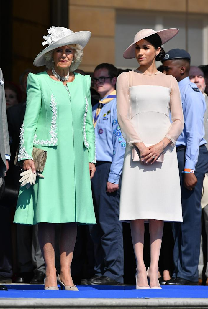 """<div class=""""caption""""> Camilla, Duchess of Cornwall and Meghan, Duchess of Sussex attend The Prince of Wales' 70th Birthday Patronage Celebration held at Buckingham Palace on May 22, 2018 in London, England. </div> <cite class=""""credit"""">WPA Pool</cite>"""