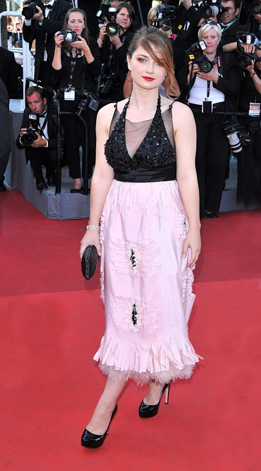 """This year's Cannes Film Festival featured a new ingenue walking the red carpet: 19-year-old <a href=""""http://movies.yahoo.com/movie/contributor/1810171356"""">Eve Hewson</a>. And while you might not recognize her face or her name, you do know her father -- U2 frontman <a href=""""http://movies.yahoo.com/movie/contributor/1800256632"""">Bono</a>.   Born Memphis Eve Hewson, the young actress is the daughter of Bono (aka Paul David Hewson) and his wife Alison. Eve has one older sister and two younger brothers. Bono has kept his children mostly out of the spotlight, but now Eve is stepping out on her own.    Eve Hewson was at Cannes for the premiere of only her second film as an actress, """"<a href=""""http://movies.yahoo.com/movie/1810172723/info"""">This Must Be the Place</a>."""" It stars <a href=""""http://movies.yahoo.com/movie/contributor/1800019044"""">Sean Penn</a> as Cheyenne, a reclusive, stuck-in-the-'80s rock star, who sets off to fulfill his late father's obsession with finding a Nazi prison guard. Hewson plays Mary, Cheyenne's teenage friend in his hometown of Dublin.    While Hewson might have had some special insight in playing a character who is close with a rocker, there was one aspect of the role she wasn't ready for. She told the <a href=""""http://www.independent.ie/national-news/all-about-eve-as-dad-a-noshow-in-cannes-2653755.html"""" target=""""_blank"""">Irish Independent</a> that she told a """"little white lie"""" in her audition: """"Paolo [Sorrentino, the director] asked me, 'Can you skateboard?' and I said, 'Yeah, sure, it's easy,' which is untrue!"""" After she got the role, she then had to be coached on how to ride in Central Park, which she said """"was very embarrassing.""""    Click ahead to see more of the glamorous arrivals on the red carpet at this year's Cannes Film Fest."""