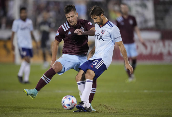 Colorado Rapids forward Diego Rubio, left, and FC Dallas midfielder Facundo Quignon vie for control of the ball in the second half of an MLS soccer match Wednesday, July 21, 2021, in Commerce City, Colo. The Rapids won 2-0. (AP Photo/David Zalubowski)