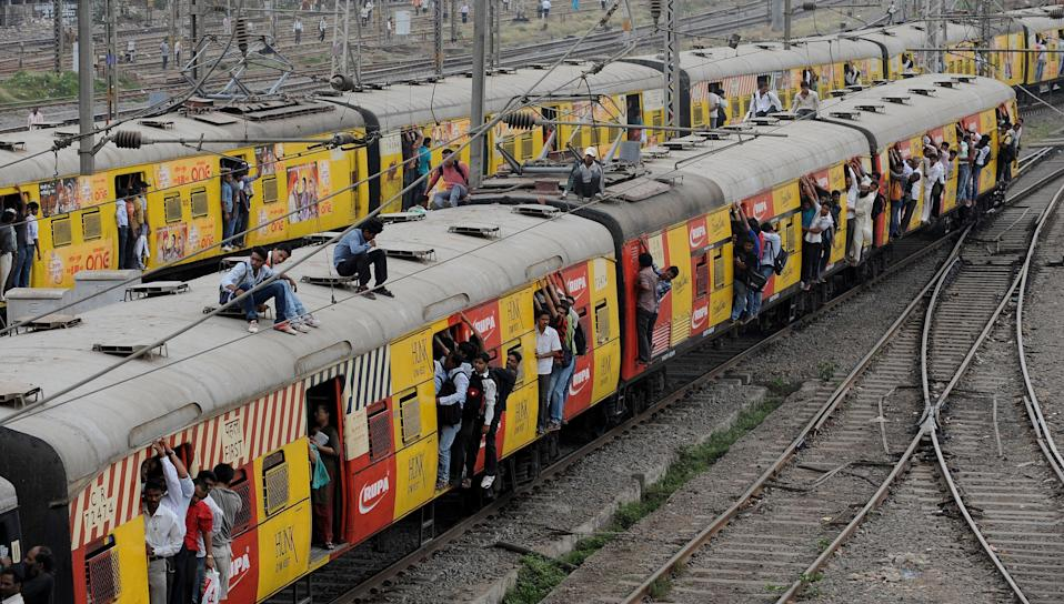 <p>Passengers walked on track of Central Railway, traffic signals stopped working and stock exchange halted work after the huge power failure in Mumbai on 12 October, 2020</p> (AFP via Getty Images)