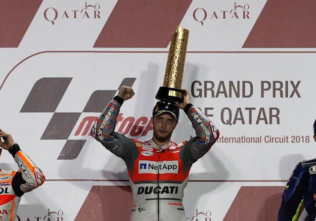 Motorcycle Racing - Qatar Motorcycle Grand Prix - MotoGP race - Losail, Qatar - March 18, 2018 - First-placed Ducati Team rider Andrea Dovizioso of Italy holds up the trophy. REUTERS/Ibraheem Al Omari