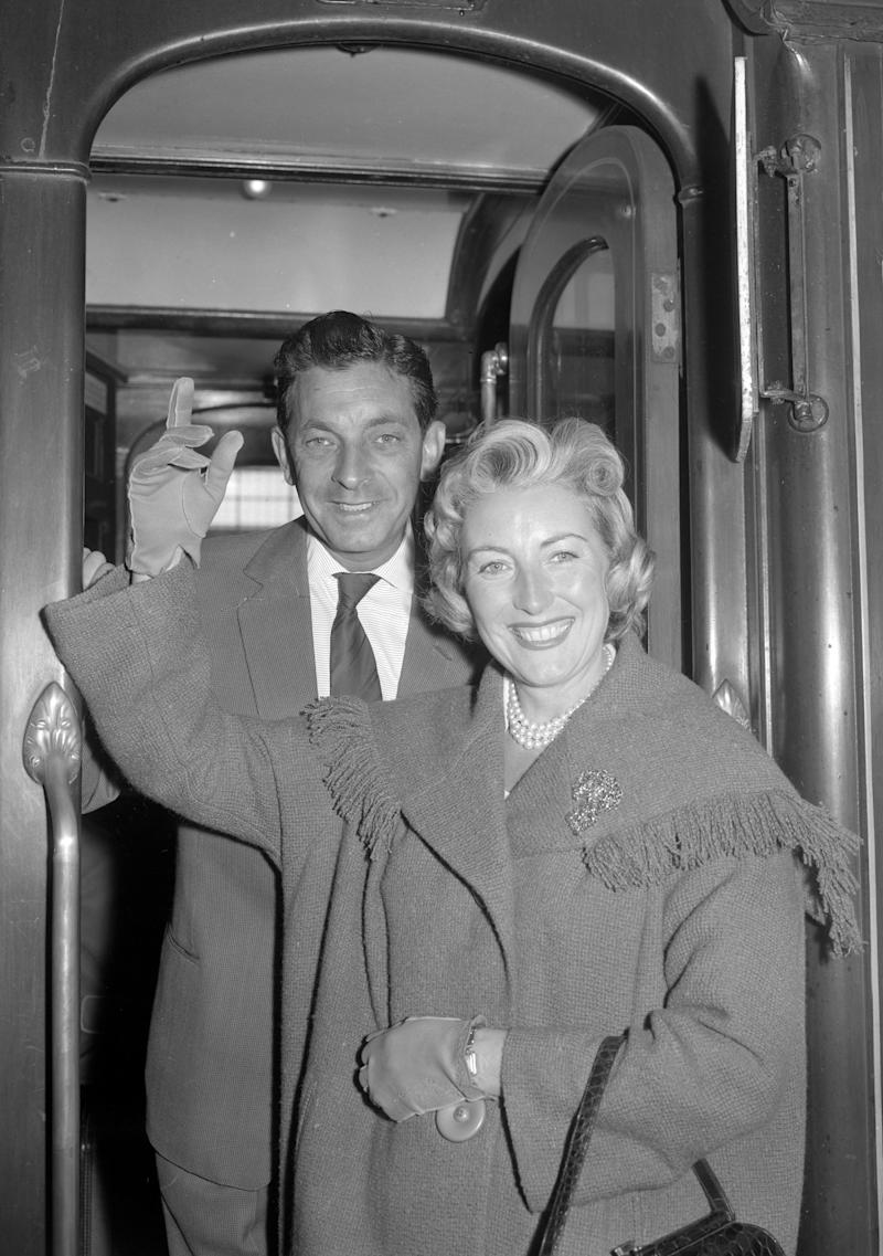 Singer Vera Lynn leaving with her husband, Harry Lewis, on a boat train from Waterloo Station, London. (Photo by PA/PA Images via Getty Images)