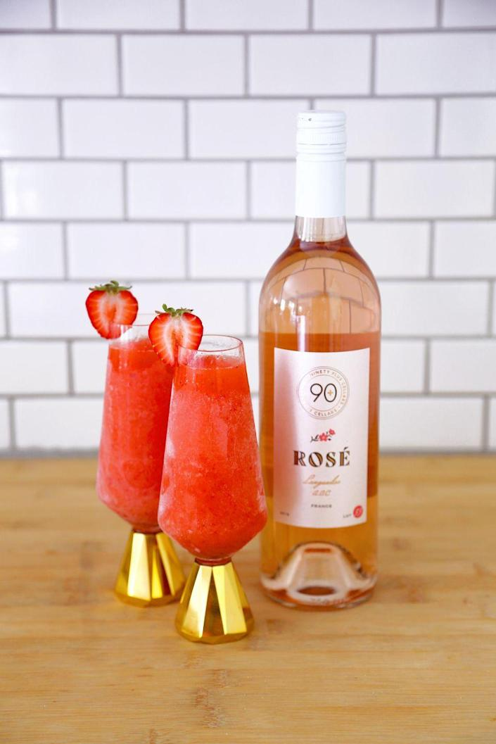 """<p>If summer had a signature drink, chances are it'd be rosé. And this frozen version—swirled with strawberries and peaches—is perfect for your Fourth of July soiree. </p><p><strong><em>Ingredients<br></em></strong>1 bottle <a href=""""https://www.ninetypluscellars.com/collections/90-wines/products/lot-33-rose-languedoc-france-2020"""" rel=""""nofollow noopener"""" target=""""_blank"""" data-ylk=""""slk:90+ Cellars Lot 33 Rosé (or whatever you have on hand)"""" class=""""link rapid-noclick-resp"""">90+ Cellars Lot 33 Rosé (or whatever you have on hand)<br></a>3 ounces spirit of choice<br>1 ½ oz lemon juice<br>1 cup frozen strawberries<br>1 cup frozen peaches</p><p><strong><em>Method</em></strong><br>Fill ice cube mold ¾ of the way with rosé and fill with a splash of water. Freeze fruit ahead of time. When ice and fruit are frozen, add all ingredients to the blender and blend. Serves four. </p>"""