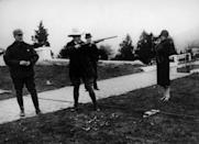 <p>Calvin Coolidge practices his rifle skills while at a shooting range in Florida in 1925. Dressed in a cowboy hat and boots, the President takes aim, while his wife, Grace, photographs him.</p>