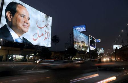 FILE PHOTO: A Cairo street sign showing Egypt's President Abdel Fattah al-Sisi ahead of the presidential election, March 25, 2018.  REUTERS/Ammar Awad/File Photo
