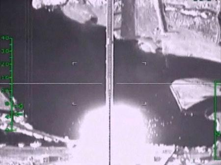 A frame grab taken from a footage released by Russia's Defence Ministry November 5, 2015, shows what Russia says is an explosion after air strikes carried out by the Russian air force on a bridge under militants' control near Raqqa, Syria. Russia's air force flew 81 sorties and hit 263 targets in Syria in the last two days, the Russian Defence Ministry said on Thursday. REUTERS/Ministry of Defence of the Russian Federation/Handout via Reuters ATTENTION EDITORS - THIS IMAGE WAS PROVIDED BY A THIRD PARTY. REUTERS IS UNABLE TO INDEPENDENTLY VERIFY THE AUTHENTICITY, CONTENT, LOCATION OR DATE OF THIS IMAGE. IT IS DISTRIBUTED EXACTLY AS RECEIVED BY REUTERS, AS A SERVICE TO CLIENTS. FOR EDITORIAL USE ONLY. NOT FOR SALE FOR MARKETING OR ADVERTISING CAMPAIGNS. NO RESALES. NO ARCHIVE. - RTX1UYTI