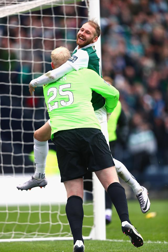 GLASGOW, SCOTLAND - APRIL 16: Conrad Logan of Hibernian is congratulated by Martin Boyle as Hibernian win the Scottish Cup Semi Final between Hibernian and Dundee United at Hampden Park on April 16, 2016 in Glasgow, Scotland. (Photo by Clive Rosel/Getty) (Photo by Clive Rose/Getty Images)