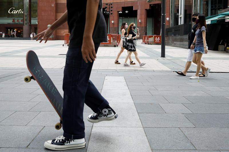 A youth plays skateboard at the shopping district of Orchard Road as the city state reopens the economy, amid the coronavirus disease (COVID-19) outbreak, in Singapore June 19, 2020. REUTERS/Edgar Su