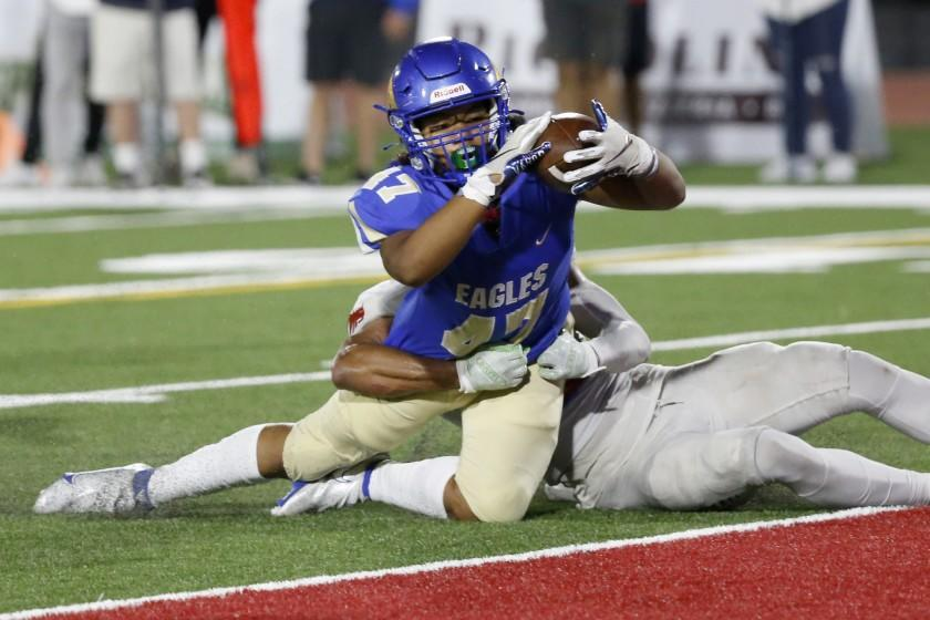 MISSION VIEJO, CA - SEPTEMBER 17: Taurian Nash (47), of Santa Margarita, tackled by Deandre Moore Jr. (2), of Los Alamitos, scores a touchdown putting the Eagles up 28-21 in the third quarter at Saddleback College Stadium on Friday, Sept. 17, 2021 in Mission Viejo, CA. Santa Margarita won 42-21 over Los Alamitos. (Gary Coronado / Los Angeles Times)