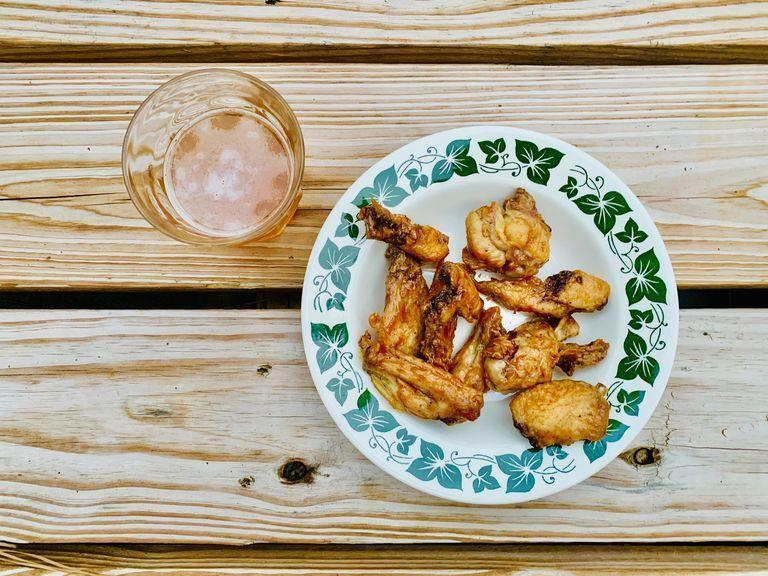 """<p>As crispy (and spicy) as you like, you can make these Buffalo wings just the way you like them. Save this recipe for the next big game day.</p><p><em><a href=""""https://www.countryliving.com/food-drinks/a33852262/air-fryer-chicken-recipe/"""" rel=""""nofollow noopener"""" target=""""_blank"""" data-ylk=""""slk:Get the recipe from Country Living >>"""" class=""""link rapid-noclick-resp"""">Get the recipe from Country Living >></a></em></p>"""