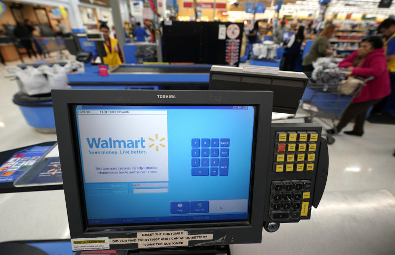 This Nov. 9, 2018, photo shows a checkout scanner at a Walmart Supercenter in Houston. Retailers will once again offer big deals and early hours to lure shoppers into their stores for the start of the holiday season. But they'll also try to get shoppers out of their stores faster than ever by minimizing the thing they hate most: long lines. (AP Photo/David J. Phillip)