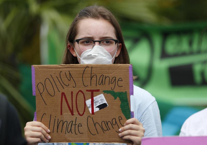 Ana Bermudez, 16, holds up a sign pleading for policy change during a demonstration. (Photo: Wilfredo Lee/AP)