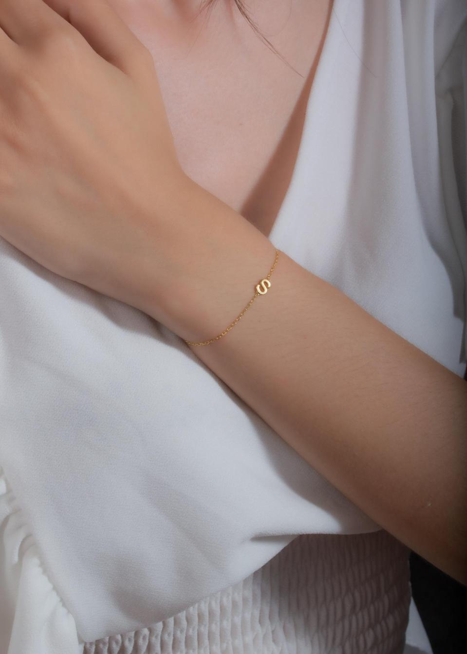 <p>You'll wear this <span>Custom JWL Letter Bracelet</span> ($18 and up) all the time.</p>