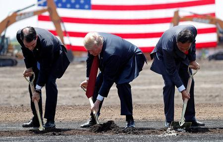 FILE PHOTO: U.S. President Donald Trump (C) takes part in a groundbreaking with Wisconsin Governor Scott Walker (L) and Foxconn Chairman Terry Gou during a visit to Foxconn's new site in Mount Pleasant, Wisconsin, U.S., June 28, 2018. REUTERS/Kevin Lamarque