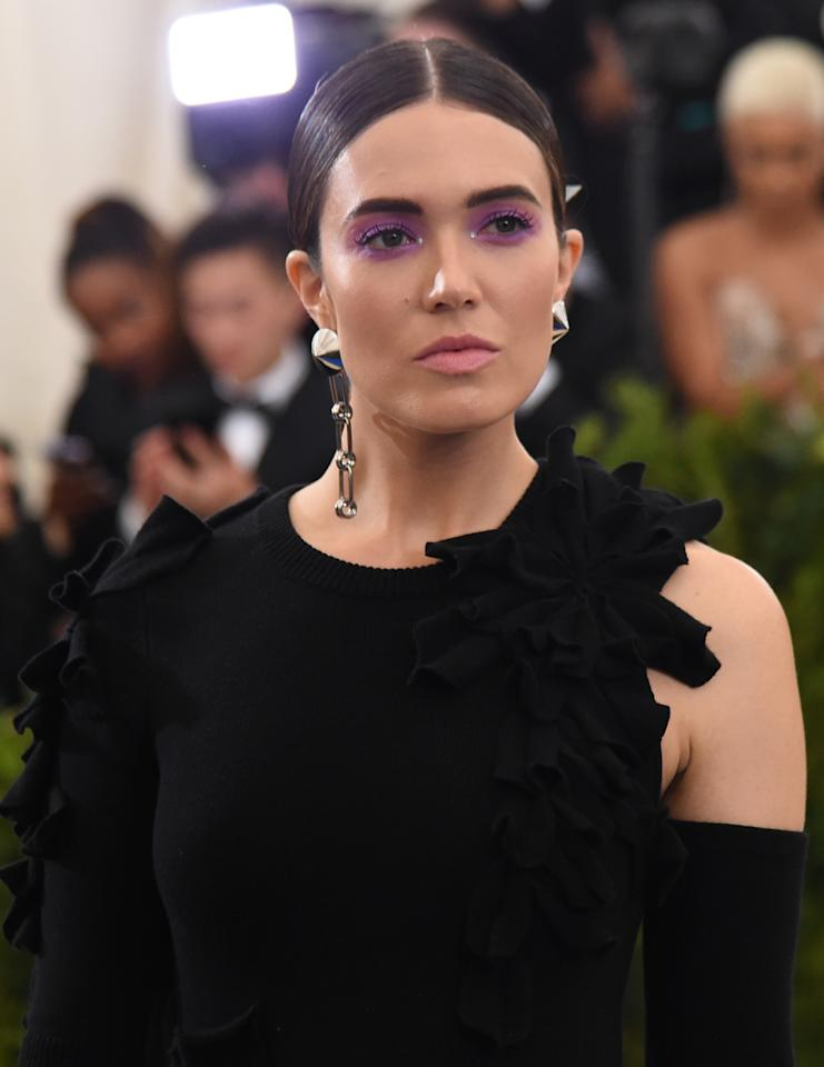 <p>Moore's lilac-washed lids, bold brows, matte lips, and slicked-back hair is nothing like we've seen her wear before, but we absolutely love it! (Photo: Getty Images) </p>