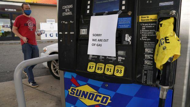 """A sign at a gas station pump reads, """"Sorry, we are out of gas."""""""
