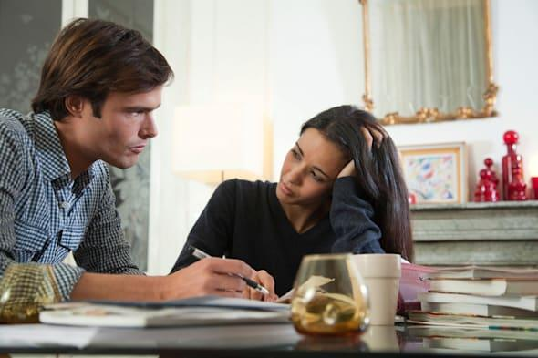 C41P60 Couple reviewing their finances together  couple; domestic; life; stress; domestic; lifestyle; home; life; mid-adult; cou
