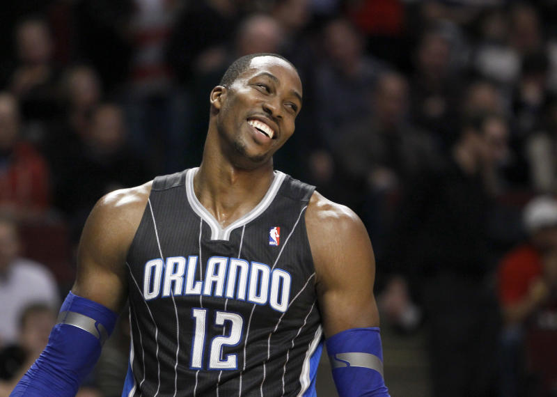Orlando Magic center Dwight Howard smiles after a play during the first half of an NBA basketball game against the Chicago Bulls, Thursday, March 8, 2012, in Chicago. (AP Photo/Charles Rex Arbogast)