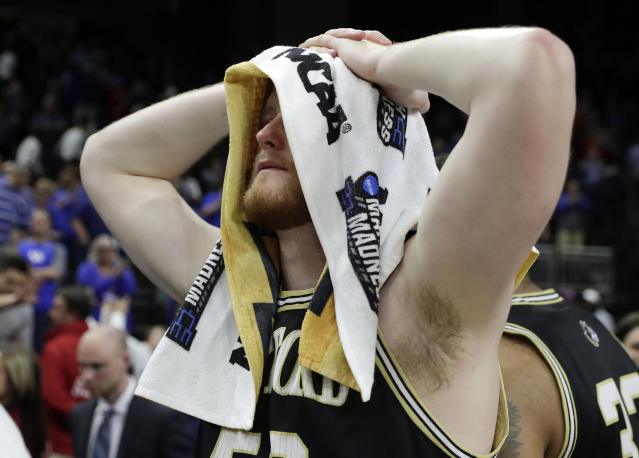 Wofford's Matthew Pegram walks off the court after losing to Kentucky in a second-round game in the NCAA mens college basketball tournament in Jacksonville, Fla., Saturday, March 23, 2019. (AP Photo/John Raoux)