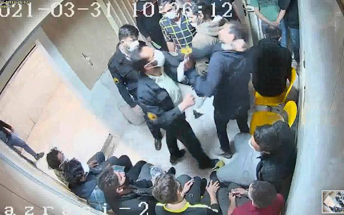 Another video grab shows guards beating a prisoner. - The Justice of Ali