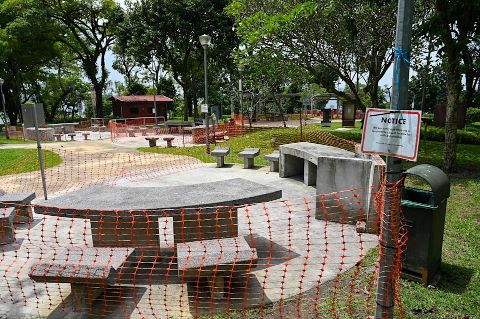 Barbeque pits are cordoned off at a park in Singapore on May 20, 2021, as the country tightened restrictions after several new clusters of Covid-19 coronavirus cases were found. (Photo by Roslan RAHMAN / AFP) (Photo by ROSLAN RAHMAN/AFP via Getty Images)