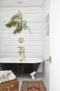 """<p>Fresh greenery is a sophisticated way to add some seasonal beauty to any room—including the bathroom. Here, a single branch of princess pine brings the look and <a href=""""https://www.countryliving.com/diy-crafts/g2851/how-to-make-your-home-smell-like-christmas/"""" rel=""""nofollow noopener"""" target=""""_blank"""" data-ylk=""""slk:smell of Christmas"""" class=""""link rapid-noclick-resp"""">smell of Christmas</a> to the space.</p><p><a class=""""link rapid-noclick-resp"""" href=""""https://go.redirectingat.com?id=74968X1596630&url=https%3A%2F%2Fwww.michaels.com%2Fheavy-snow-pine-needle-branch-with-berry-by-ashland%2F10559846.html&sref=https%3A%2F%2Fwww.countryliving.com%2Fhome-design%2Fdecorating-ideas%2Fadvice%2Fg1247%2Fholiday-decorating-1208%2F"""" rel=""""nofollow noopener"""" target=""""_blank"""" data-ylk=""""slk:SHOP PINE BRANCHES"""">SHOP PINE BRANCHES</a></p>"""