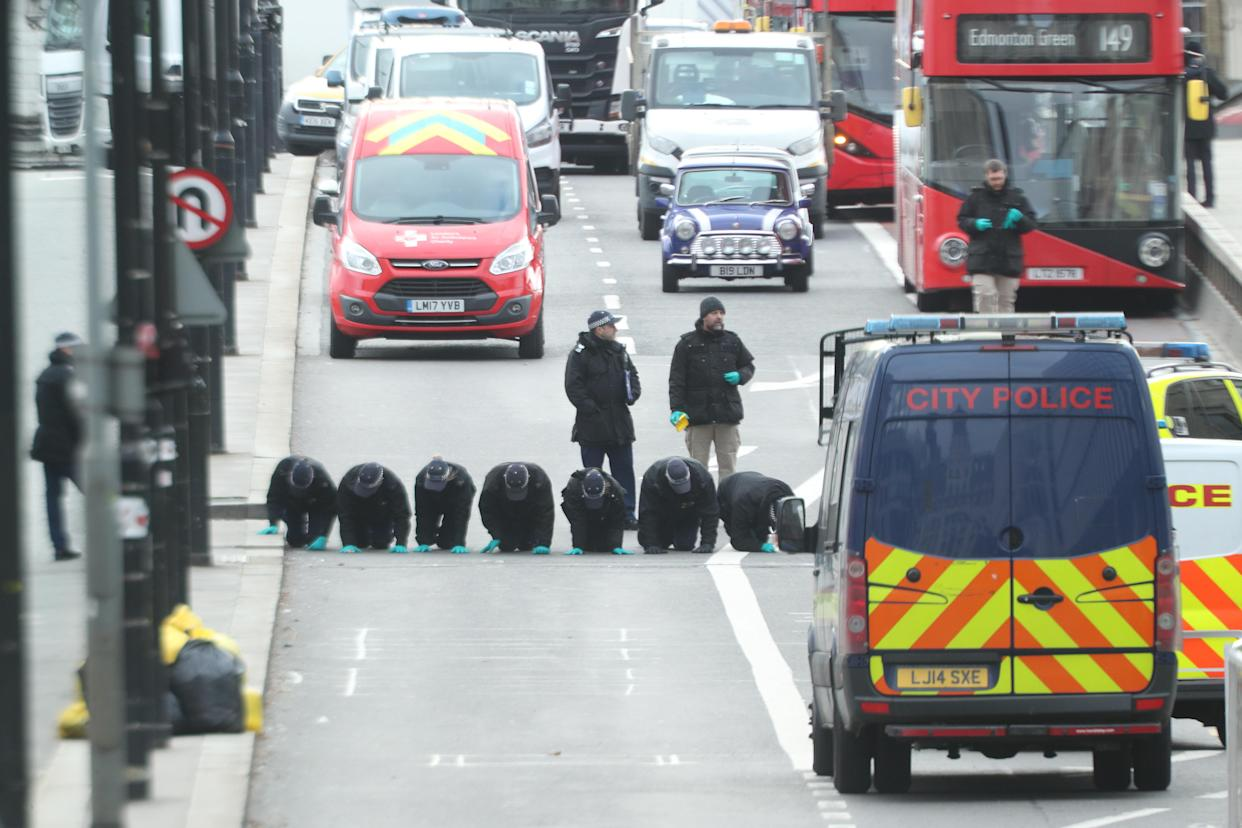 A forensic team on London Bridge in central London after the terrorist attack (PA/Getty)