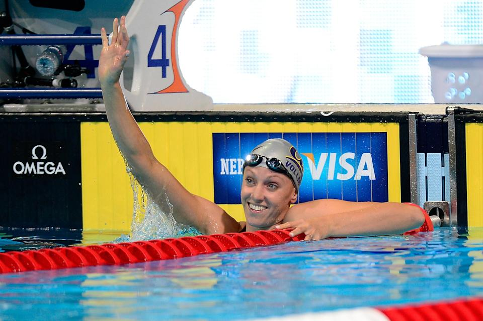 OMAHA, NE - JUNE 25: Dana Vollmer reacts after she set a new american record while competing in heat 17 of the Women's 100 m Butterfly during the 2012 U.S. Olympic Swimming Team Trials at CenturyLink Center on June 25, 2012 in Omaha, Nebraska. (Photo by Jamie Squire/Getty Images)