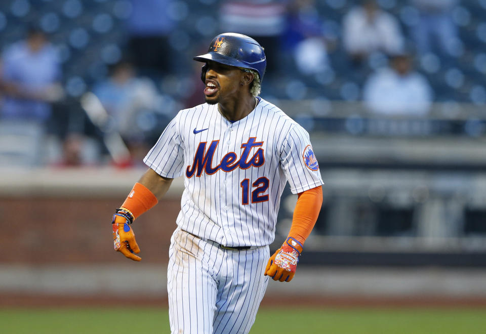 New York Mets shortstop Francisco Lindor reacts after hitting a home run against the Atlanta Braves during the second inning of a baseball game Wednesday, June 23, 2021, in New York. (AP Photo/Noah K. Murray)