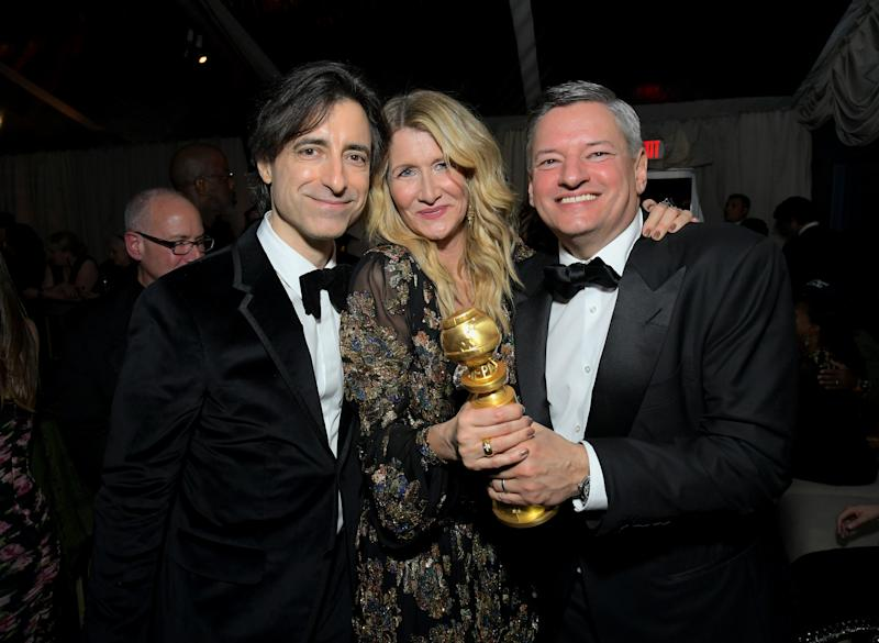 LOS ANGELES, CALIFORNIA - JANUARY 05: Noah Baumbach, Laura Dern, winner of the Actress in a Supporting Role in Any Motion Picture award for 'Marriage Story', and Netflix Chief Content Officer Ted Sarandos attend the Netflix 2020 Golden Globes After Party on January 05, 2020 in Los Angeles, California. (Photo by Charley Gallay/Getty Images for Netflix)