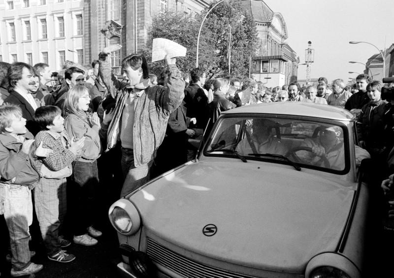 FILE PHOTO: West Berlin citizens welcome East Germans who came across the Berlin Wall in 1989
