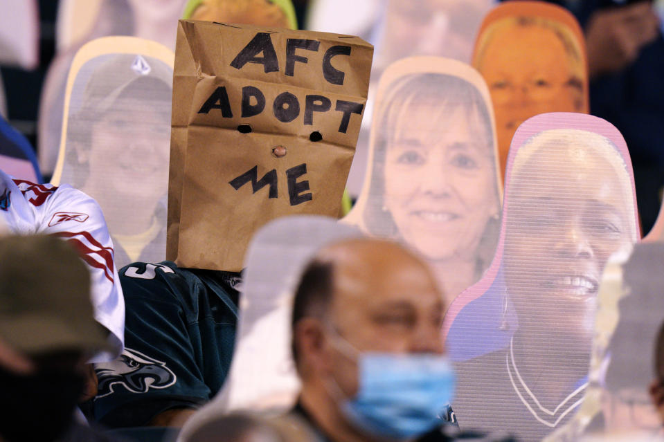A Philadelphia Eagles' fan wears a paper bag during the second half of an NFL football game against the New York Giants, Thursday, Oct. 22, 2020, in Philadelphia. (AP Photo/Chris Szagola)