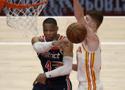 Washington Wizards' Russell Westbrook, left, passes away from Atlanta Hawks' Kevin Huerter in the second half of an NBA basketball game Monday, May 10, 2021, in Atlanta. (AP Photo/Ben Margot)