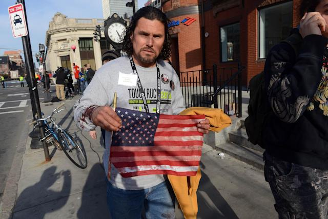 BOSTON, MA - APRIL 15: Carlos Arredondo, who was at the finish line of the 117th Boston Marathon when two explosives detonated, leaves the scene on April 15, 2013 in Boston, Massachusetts. Two people are confirmed dead and at least 28 injured after at least two explosions went off near the finish line to the marathon. (Photo by Darren McCollester/Getty Images)