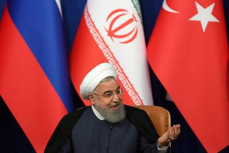 Iranian President Rouhani speaks during a news conference with President Erdogan of Turkey and Putin of Russia following their meeting in Tehran