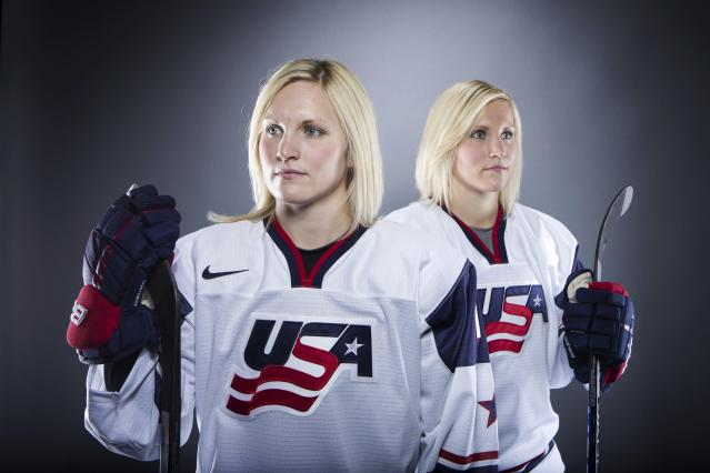 Olympic ice hockey players Jocelyne Lamoureux (L) and Monique Lamoureux pose for a portrait during the 2013 U.S. Olympic Team Media Summit in Park City, Utah October 2, 2013. REUTERS/Lucas Jackson (UNITED STATES - Tags: SPORT OLYMPICS PORTRAIT ICE HOCKEY)