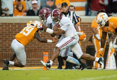 Oct 20, 2018; Knoxville, TN, USA; Alabama Crimson Tide quarterback Jalen Hurts (2) runs between Tennessee Volunteers defensive lineman Shy Tuttle (2) and defensive back D.J. Henderson (39) for a touchdown in the third quarter of a game at Neyland Stadium. Alabama defeated the Vols 58-21. Bryan Lynn-USA TODAY Sports