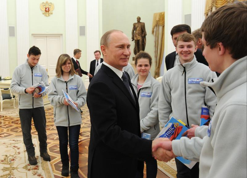 Russian President Vladimir Putin meets with young skiers, participants in the expedition to the North Pole, in the Kremlin in Moscow, Russia, Tuesday, April 22, 2014. (AP Photo/RIA-Novosti, Mikhail Klimentyev, Presidential Press Service)