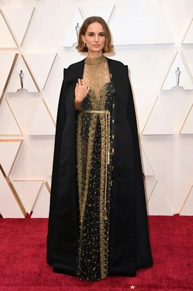Actress Natalie Portman wears the cape containing the names of female filmmakers who were not nominated for a best director Oscar