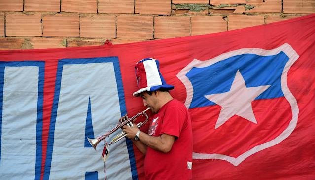 A Chile supporter plays the trumpet outside the Toca da Raposa training site in Belo Horizonte, where Chile are training on June 25, 2014, during the 2014 FIFA World Cup football tournament (AFP Photo/Martin Bernetti)