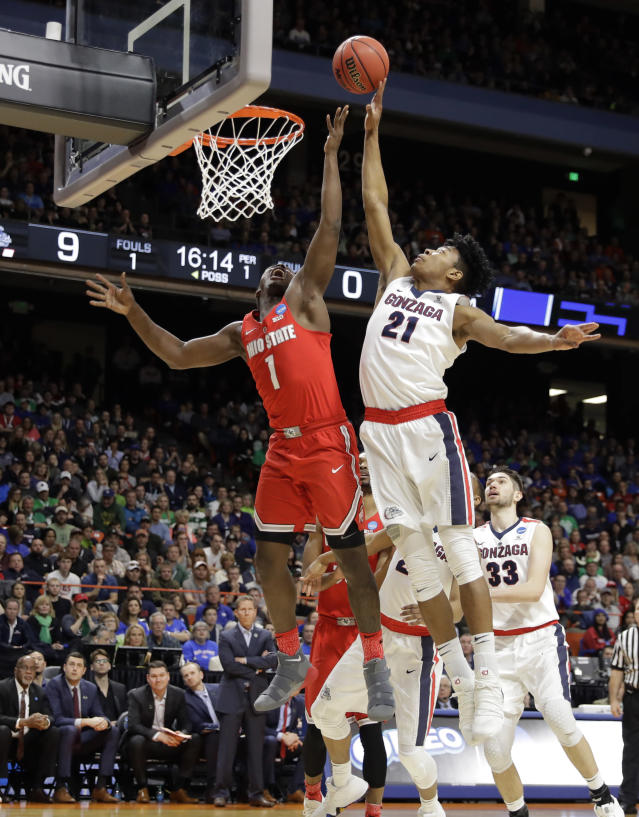 Gonzaga forward Rui Hachimura (21) blocks a shot by Ohio State forward Jae'Sean Tate (1) during the first half of a second-round game in the NCAA men's college basketball tournament Saturday, March 17, 2018, in Boise, Idaho. (AP Photo/Otto Kitsinger)